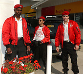 """Kensington, MD - October 22, 2002 -- Guardian Angels await motorists at the Shell gas station where lori Lewis-Rivera was killed by the """"Beltway Sniper"""" on 3 October, 2002.  The Angels were at the station to pump gas for motorists afraid to pump gas on their own. Left to right: Ted Fowler, a Karate Teacher from Denver, Colorado; Carlos Del Aguila, New York; and Sebastian Metz, a Denver, Colorado Community Worker.<br /> Credit: Ron Sachs / CNP<br /> (RESTRICTION: NO New York or New Jersey Newspapers or newspapers within a 75 mile radius of New York City)"""