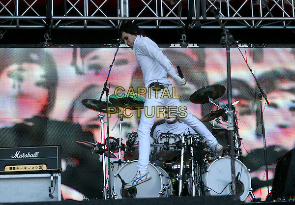 30 SECONDS TO MARS - JARED LETO.Perfoming live at The 2006 KROQ 106.7 Inland Invasion held at The Hyundai Pavilion in San Bernadino, California, USA, September 23rd 2006..full length concert gig festival music funny jumping band white suit costume on stage.Ref: DVS.www.capitalpictures.com.sales@capitalpictures.com.©Debbie VanStory/Capital Pictures