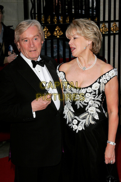 WILLIAM ROACHE & SARA McEWAN.The Galaxy British Book Awards held at the Grosvenor Hotel, Park Lane, London, England..April 9th, 2008.half length black tuxedo bow tie tuxedo white pattern dress off the shoulder pearl necklace married husband wife .CAP/AH.©Adam Houghton/Capital Pictures.