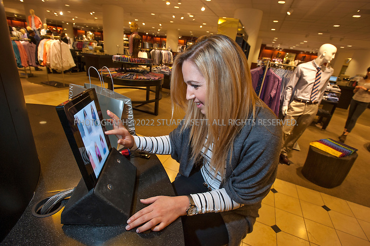 3/1/2012--Seattle, WA, USA..In the men's department at Nordstrom in Seattle, WASH., an iPad is provided to customers to help them browse the store's website and catalog for items...Here customer Amela Mesak searches for items....©2012 Stuart Isett. All rights reserved.