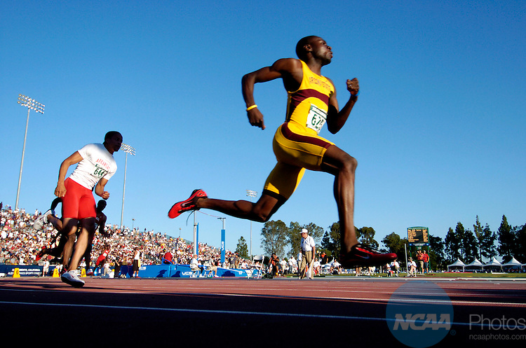 11 JUNE 2005: The field of runners sprints off of the blocks during the men's 200 meter race at the Division 1 Track and Field Championship held at the Alex G. Spanos Sports Complex in Sacramento, CA. Wallace Spearmon of Arkansas won the race with a time of 19.91. Rich Clarkson/NCAA Photos
