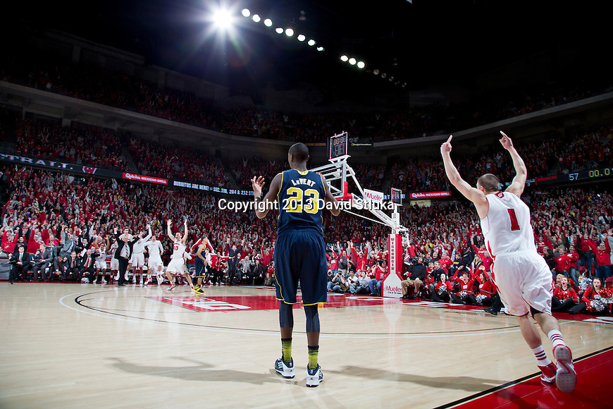 Wisconsin Badgers guard Ben Brust (1) celebrates a 3-pointer as time expires in regulation to tie the game during a Big Ten Conference NCAA college basketball game against the Michigan Wolverines Saturday, February 9, 2013, in Madison, Wis. The Badgers won 65-62 (OT). (Photo by David Stluka)