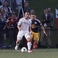 New England Revolution forward Chad Barrett (9) controls the ball as New York Red Bulls midfielder Brandon Barklage (25) closes. 2013 Lamar Hunt U.S Open Cup fourth round, New England Revolution (white) defeated New York Red Bulls (blue/yellow), 4-2, at Harvard University's Soldiers Field Soccer Stadium on June 12, 2013.