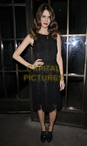 Jade Williams aka Sunday Girl.The InStyle Best Of British Talent party, Shoreditch House, Ebor St., London, England..January 26th, 2012.full length black sleeveless dress hand on hip ankle boots shoes lace .CAP/CAN.©Can Nguyen/Capital Pictures.