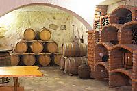 Wine cellar with barrels and bottle bins. Matusko Winery. Potmje village, Dingac wine region, Peljesac peninsula. Matusko Winery. Dingac village and region. Peljesac peninsula. Dalmatian Coast, Croatia, Europe.