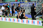 The Hague, Netherlands, June 08: Hugo Inglis #29 of New Zealand and Marcus Child #13 of New Zealand sit on the banner after the field hockey group match (Men - Group B) between the Black Sticks of New Zealand and Germany on June 8, 2014 during the World Cup 2014 at Kyocera Stadium in The Hague, Netherlands.  Final score 3-5 (1-3) (Photo by Dirk Markgraf / www.265-images.com) *** Local caption ***