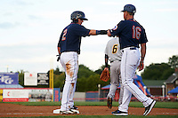 Binghamton Mets shortstop Gavin Cecchini (2) fist bumps manager Pedro Lopez (16) during a game against the Trenton Thunder on August 8, 2015 at NYSEG Stadium in Binghamton, New York.  Trenton defeated Binghamton 4-2.  (Mike Janes/Four Seam Images)