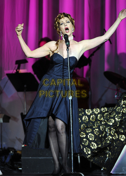 **EXCLUSIVE ALL ROUNDER**.SHARON LAWRENCE .at the Les Girls 10th Annual Cabaret fundraiser for National Breast Cancer Coalition Fund NBCCF held at Avalon in Hollywood, California, USA, .October 4th 2010.   .full length concert on stage performing   music  singing blue navy  bustier strapless dress taking off                                    .CAP/RKE/DVS.©DVS/RockinExposures/Capital Pictures.