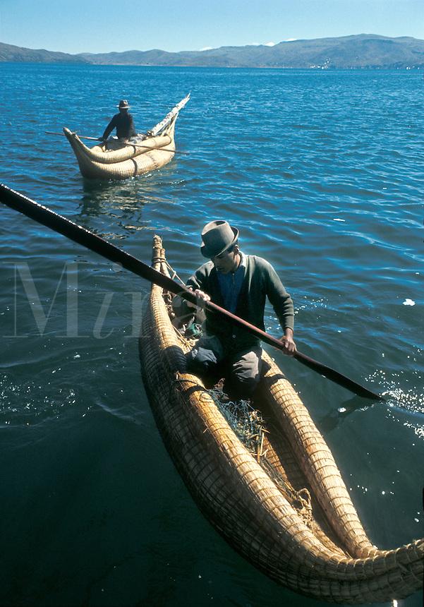 Aymara Indian fishermen in reed rafts called  balsa de totora, on Lake Titicaca, Bolivi