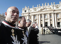 Membri del Sovrano Militare Ordine di Malta, in processione verso la Basilica di San Pietro, per la messa di celebrazione dei 900 anni dell'Ordine, in Piazza San Pietro, Citta' del Vaticano, 9 febbraio 2013..Members the Sovereign Military Order of Malta walk in procession towards St. Peter's Basilica, to attend a mass marking the Order's 900th anniversary, in St. Peter's square, Vatican, 9 February 2013..UPDATE IMAGES PRESS/Riccardo De Luca