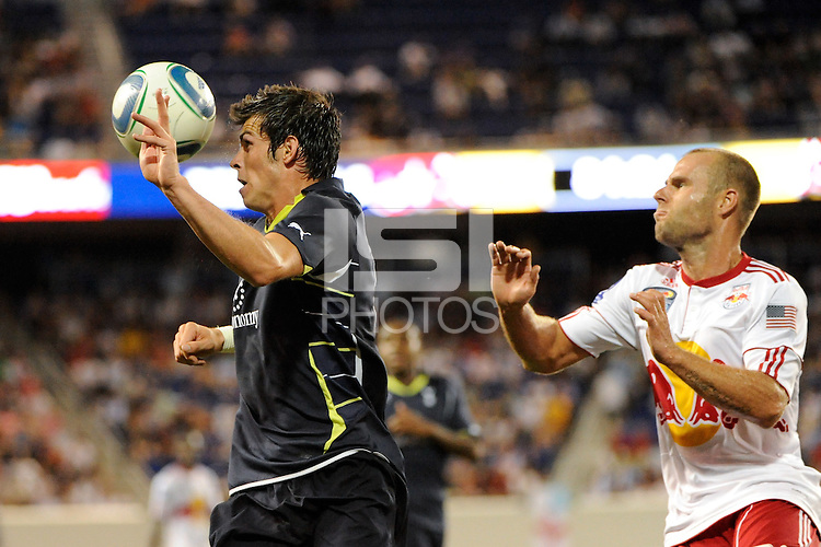 Garreth Bale (3) heads the ball. Tottenham Hotspur F. C. defeated the New York Red Bulls 2-1 during a Barclays New York Challenge match at Red Bull Arena in Harrison, NJ, on July 22, 2010.
