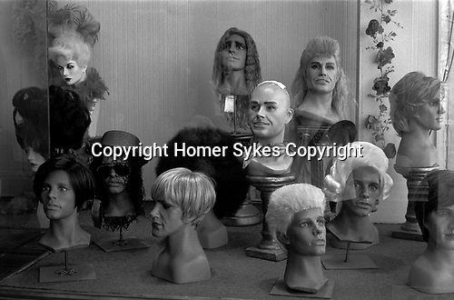 Wig display shop window USA.