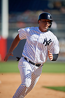 New York Yankees first baseman Ryan McBroom (73) runs the bases during a Grapefruit League Spring Training game against the Toronto Blue Jays on February 25, 2019 at George M. Steinbrenner Field in Tampa, Florida.  Yankees defeated the Blue Jays 3-0.  (Mike Janes/Four Seam Images)