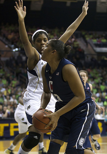 March 04, 2013:  Connecticut forward Kaleena Mosqueda-Lewis (23) goes up for a shot as Notre Dame forward Ariel Braker (44) defends during NCAA Basketball game action between the Notre Dame Fighting Irish and the Connecticut Huskies at Purcell Pavilion at the Joyce Center in South Bend, Indiana.  Notre Dame defeated Connecticut 96-87 in triple overtime.