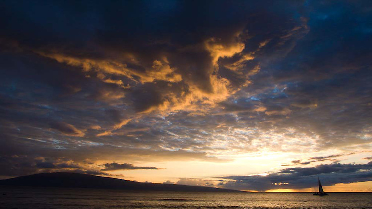 Sun setting as viewed from the West side of the island of Maui, HI, USA