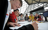 Dame Ellen MacArthur photographed in the Glasgow Science Centre where she hosted the first in a series of 'Project Re-Design' events across the UK run by the Ellen MacArthur Foundation. Picture shows Dame Ellen with students from Beath High School - Cowdenbeath - who were amongst a group of teams from around Scotland who were challenged to turn the UK's 'waste to landfill' problem into a potential opportunity by re-thinking the way the system works. One team from Glasgow will win a fully funded internship with one of the founding partners -B&Q - BT - CISCO - National Grid and Renault - Picture by Donald MacLeod - 01.3.11 - 07702 319 738 - www.donald-macleod.com