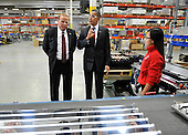 United States President Barack Obama (C) tours Orion Energy Systems, Inc. with founder and CEO Neal Verfuerth (L)  in Manitowoc, Wisconsin on Wednesday, January 26, 2011. President Obama, Vice President Joe Biden and other members of the President's Cabinet traveled across the country Wednesday to highlight the administration's efforts to rebuild the American economy.   .Credit: Brian Kersey / Pool via CNP