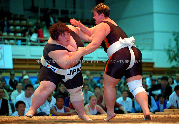 10/26/2001--Hirosaki, Aomori Prefecture, Japan..Rie Tsuihiji (left) Vs. Sandra Koppemn Germany  (right) at the World internationl sumo tournament...All photographs ©2003 Stuart Isett.All rights reserved.This image may not be reproduced without expressed written permission from Stuart Isett.