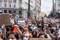 MADRID, SPAIN - JUNE 7: People sit at Puerta del Sol square and show placards during the demonstration organized in support of George Floyd and against the racism on June 07 2020, in Madrid, Spain. This demonstration, which began at the USA Embassy, has been produced in the middle of de escalation plans due to COVID-19 outbreak in Spain. The death of George Floyd by police in United States has caused protests against institutional racism and boosted the Black Live Matter movement across the country. It has created an anti-racism movement in multiples cities of Europe as well. (Photo by Sergio Belena/VIEWpress via Getty Images).