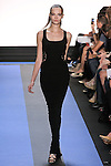Mina walks runway in a carbon black crepe racer back lace gown, by Monique Lhuillier, from the Monique Lhuillier Spring 2012 collection fashion show, during Mercedes-Benz Fashion Week Spring 2012.