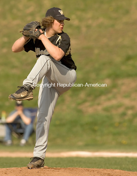 BEACON FALLS, CT- 23 APRIL 2008 --042308JS09--Woodland's Mark McKay (12) delivers a pitch during their game against Wilby Wednesday at Woodland Regional High School in Beacon Falls. <br /> Jim Shannon / Republican-American