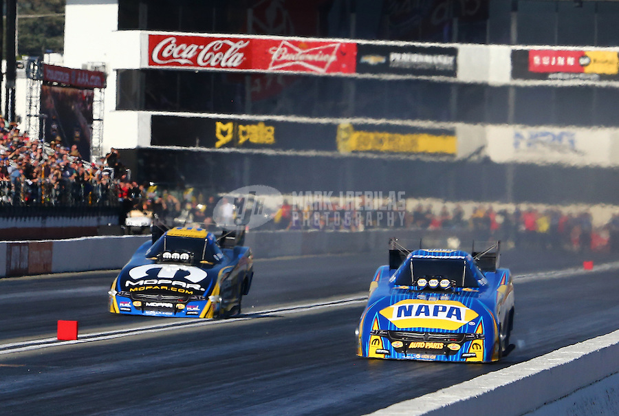 Feb 12, 2017; Pomona, CA, USA; NHRA funny car driver Matt Hagan (left) nearly crosses the center line alongside Ron Capps during the Winternationals at Auto Club Raceway at Pomona. Mandatory Credit: Mark J. Rebilas-USA TODAY Sports