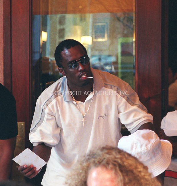 *** EXCLUSIVE***..Music mogul Sean (Puff Daddy, P. Diddy) Combs teams up with Russell Simmons to tape a segment for upcoming TV Show name of which has not been revealed. Cipriani Restaurant on West Broadway in SoHo, New York. July 10, 2002. Please byline: Alecsey Boldeskul/NY Photo Press.   ..*PAY-PER-USE*      ....NY Photo Press:  ..phone (646) 267-6913;   ..e-mail: info@nyphotopress.com