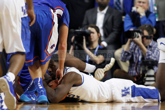 UK forward Alex Poythress guarding a loose ball during the second half of  the UK basketball game vs. Boise State on Tuesday, December 10, 2013, in Lexington, Ky. Photo by Kalyn Bradford | Staff