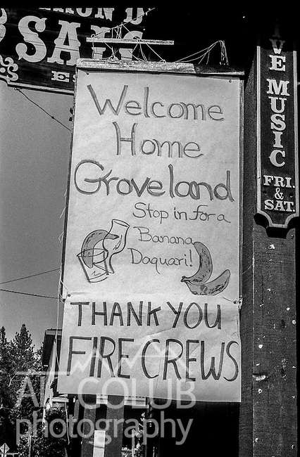 September 8, 1987 Yosemite National Park, California -- Stanislaus Complex Fire  -- Groveland bar owner puts up a banner to express his thanks to firefighters leaving the  Stanislaus National Forest. The Stanislaus Complex Fire consumed 28 structures and 145,980 acres.  One US Forest Service firefighter, David Ross Erickson, died from a tree-felling accident.
