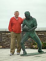 Mick O'Dwyer beside his stature in Waterville.<br /> Photo Don MacMonagle