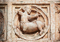 Medieval relief sculptures of mythical centaur on the exterior of the Romanesque Baptistery of Parma, circa 1196, (Battistero di Parma), Italy