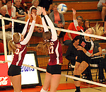 SIOUX FALLS, SD - OCTOBER 1:  Paige Rome #10 and Maggie DeJong #17 and from Roosevelt double team for a block against Peyton VandeBrake #15 from Washington in the third game of their match Tuesday night at Washington. (Photo by Dave Eggen/Inertia)
