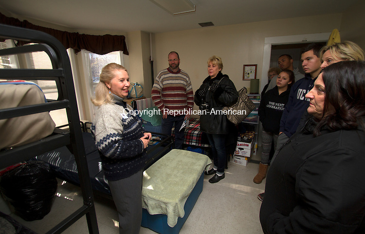 TORRINGTON, CT - 21 NOVEMBER 2015 -112115JW04.jpg -- Executive Director / CEO of FISH NWCT Deidre Houlihan DiCara talks about the living arrangements in the womans dorm room at the shelter during an open house Saturday morning.  Jonathan Wilcox Republican-American