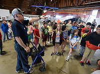 NWA Democrat-Gazette/ANDY SHUPE<br /> Volunteer interpreter Jeff Gates explains the origins of several aircraft on display Tuesday, May 14, 2019, for students from Lowell Elementary School as they tour the Arkansas Air and Military Museum in Fayetteville. The students spent the morning learning about flight and the history of aviation in Northwest Arkansas.
