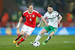Oliver Norwood of Northern Ireland closes down David Vaughan of Wales during the international friendly match at the Cardiff City Stadium. Photo credit should read: Philip Oldham/Sportimage