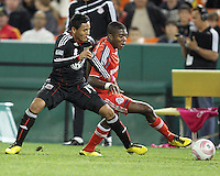 Andy Najar #14 of D.C. United blocks Nicholas Lindsay #37 of Toronto FC during an MLS match that was the final appearance of D.C. United's Jaime Moreno at RFK Stadium, in Washington D.C. on October 23, 2010. Toronto won 3-2.