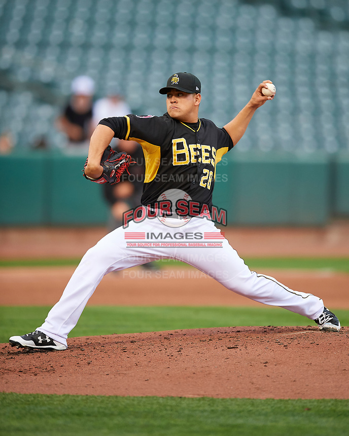 Salt Lake Bees starting pitcher Manny Banuelos (28) delivers a pitch to the plate against the Fresno Grizzlies in Pacific Coast League action at Smith's Ballpark on April 17, 2017 in Salt Lake City, Utah. The Bees defeated the Grizzlies 6-2. (Stephen Smith/Four Seam Images)