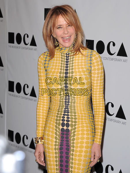 """Rosanna Arquette .at The 2011 MOCA Gala """"An Artist's Life Manifesto"""" With Artistic Direction From Marina Abramovic held at MOCA Grand Avenue in Los Angeles, California, USA, .November 12th 2011..half length  grey gray yellow long sleeve dress print purple circles mouth open                  .CAP/RKE/DVS.©DVS/RockinExposures/Capital Pictures."""