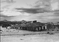 Photograph of the Enlisted Men's barracks in 1938, before restoration, exhibited at the Fort Davis National Historic Site, a US army fort established 1854, in a canyon in the Davis Mountains in West Texas, USA. The fort was built to protect emigrants, mail coaches, and freight wagons on the trails through the State from Comanche and Apache Indians. After the Civil War, several African-American regiments were stationed here. By the 1880s, the fort consisted of one 100 buildings, housing over 400 soldiers. It was abandoned in 1891, but many buildings have been restored and the compound now operates as a historical site and museum. Picture by Manuel Cohen