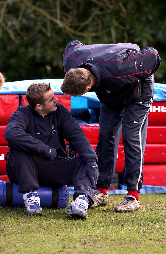 Photo. Richard Lane. .England Training at Pennyhill Hotel, Bagshot. 06/03/2003.James Simpson-Daniel gets words of encouragement from Will Greenwood as he sits out training..