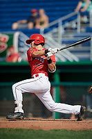 Batavia Muckdogs third baseman Bubba Hollins (24) follows through on a swing during a game against the Auburn Doubledays on September 2, 2018 at Dwyer Stadium in Batavia, New York.  Batavia defeated Auburn 5-4.  (Mike Janes/Four Seam Images)