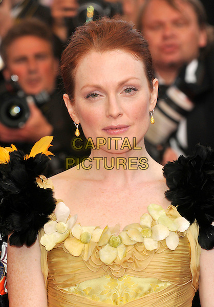 "JULIANNE MOORE.at the screening of ""Blindness"", the opening film at the.61st Cannes International  Film Festival .14th May 2008 .gala premiere portrait headshot black feathers green yellow flowers earrings .CAP/PL.© Phil Loftus/Capital Pictures"