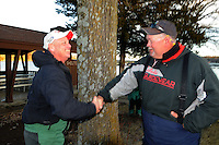 NWA Democrat-Gazette/FLIP PUTTHOFF<br /> J.R. Beehler (left) and Rickey Searcy celebrate Friday Jan. 1, 2016 after winning the annual Polar Bear Bass Tournament at Beaver Lake. They weighed five bass totaling 14.41 pounds.