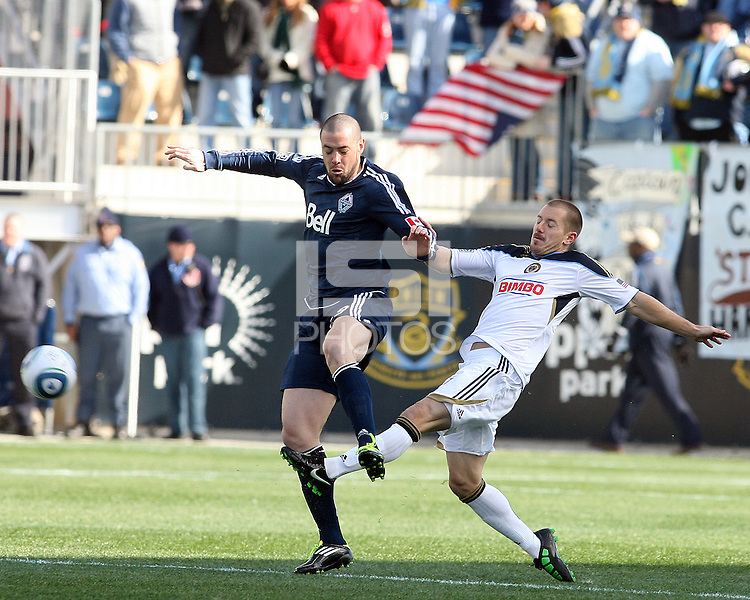 Jordan Harvey#2 of the Philadelphia Union kicks the ball away from Eric Hassli#29 of the Vancouver Whitecaps during an MLS match at PPL Park in Chester, PA. on March 26 2011. Union won 1-0.