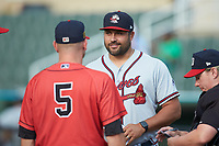 Rome Braves manager Matt Tuiasosopo (27) meets with Kannapolis Intimidators manager Ryan Newman (5) and home plate umpire Jennifer Pawol prior to their South Atlantic League game at Kannapolis Intimidators Stadium on July 2, 2019 in Kannapolis, North Carolina.  The Intimidators walked-off the Braves 5-4. (Brian Westerholt/Four Seam Images)