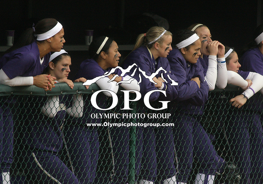 28 May 2010:  Washington Huskies bench players watch from the dug out against Oklahoma.  Washington defeated Oklahoma 3-0 in the second game of the NCAA Super Regional at Husky Softball Stadium in Seattle, WA.