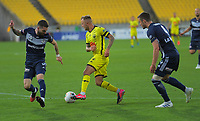 David Ball weaves through the defence to score during the A-League football match between Wellington Phoenix and Melbourne Victory FC at Sky Stadium in Wellington, New Zealand on Sunday, 15 March 2020. Photo: Dave Lintott / lintottphoto.co.nz