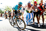 Omar Fraile (ESP) Astana Pro Team attacks on the final climb passing Obelix character during Stage 14 of the 2018 Tour de France running 188km from Saint-Paul-Trois-Chateaux to Mende, France. 21st July 2018. <br /> Picture: ASO/Alex Broadway | Cyclefile<br /> All photos usage must carry mandatory copyright credit (&copy; Cyclefile | ASO/Alex Broadway)