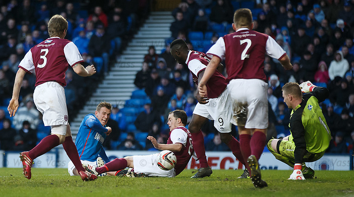 Dean Shiels tries a shot but is crowded out