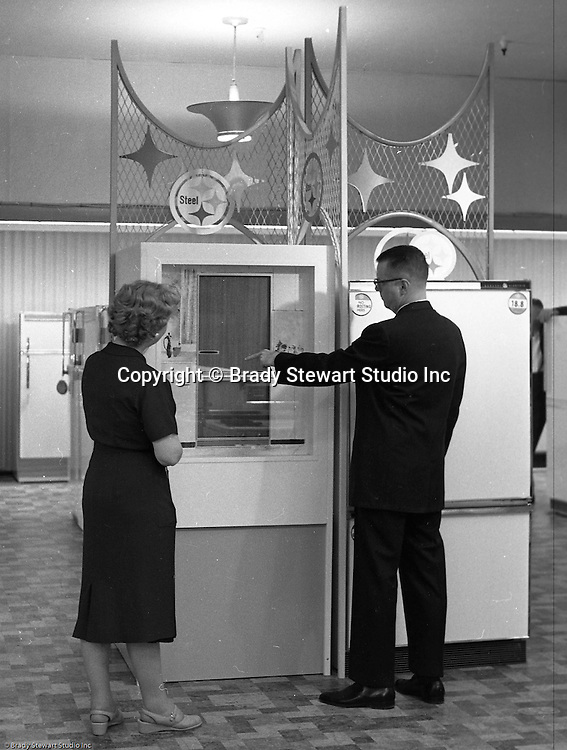 Pittsburgh PA: View of Christmas in store display at Horne's department store in downtown Pittsburgh. Customers shopping for a new refrigerator surrounded by a steel display during the Rhapsody of Steel campaign.  US Steel launched an awareness campaign of all the current uses of steel in everyday products.  During this time, ALCOA Aluminum Company of America also headquartered in Pittsburgh, was aggressively competing to enter markets where US  steel companies traditional dominated market share. Examples included beer and food Cans, appliances, automobile parts, children toys / bicycles, and more.